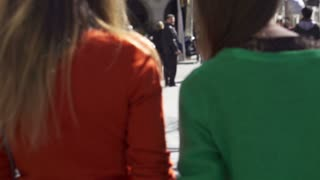 Women walking with shopping bags on the street, slow motion shot at 240fps