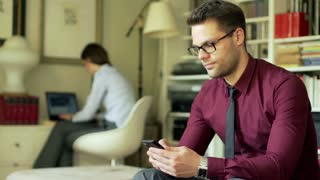 Worried businessman receiving bad news on cellphone