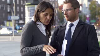 Young business couple having fight on the street