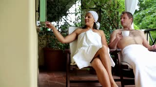 Young couple drinking tea and relaxing in spa resort, outdoors