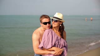 Young couple standing on the beach and talking