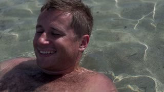 Young man relaxing in the sea, slow motion shot at 240fps