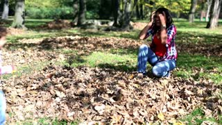 Young mother having fun with her son in beautiful autumn park, stedycam shot