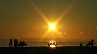 Beautiful Sunset and Peaple at Seaside