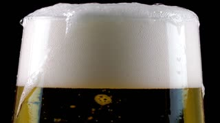 Beer and foam on black background