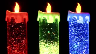 Candle lamps with glittering particles in liquid