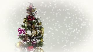 Christmas tree with ornaments and snowfall