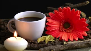 Cup of Coffee and Red Flower