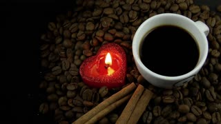 Cup of Coffee & Heart Candle on Coffee Beans