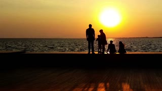 Family at Beautiful Sunset