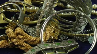 Gold and silver jewellery rotating