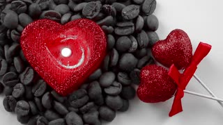 Heart Shaped Candle in Coffee Beans and Glittering Red Hearts