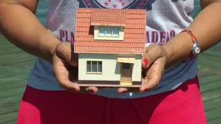 Model House in Woman Hands