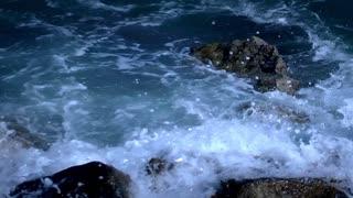 Ocean waves crashing rocks