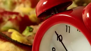 Pizza time-Delicious pizza and clock- zoom out