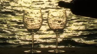 Pouring Wine into Glasses at Sunset 2