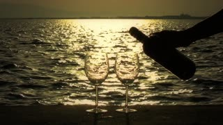 Pouring Wine into Glasses at Sunset Time