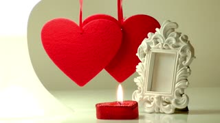 Red hearts,candle and white frame