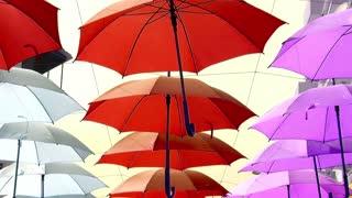 Red,white,pink umbrellas street