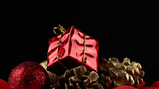 Rotating christmas ornaments and gift
