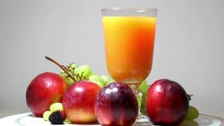 Rotating fresh fruits and fruit juice