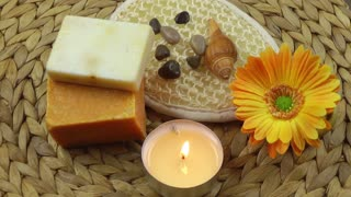 Spa concept with candle,flower,soaps and stones