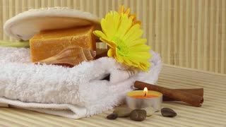 Spa concept with candle,flowers,towel,soaps and stones