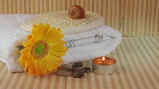 Spa concept with candle,flower,towel and stones
