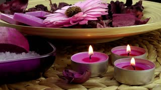 Spa concept with candles and dry flowers
