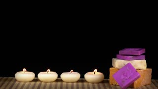 Spa concept with candles and soaps  on wooden background