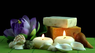 Spa concept with candles,seashells,soaps and waterlily