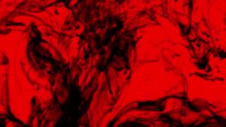 Underwater ink smoke on red background