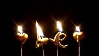Burning golden love candles-Valentines day