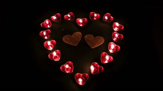 Burning heart candles and glittering hearts-Valentines day