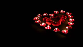 Burning heart candles with rose petals and glittering heart -Valentines day