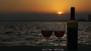 Wine glasses and bottle at sunset-Timelapse