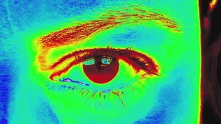 Woman eye under neon lights