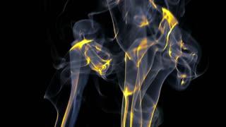 Yellow and grey Silky smoke on black background
