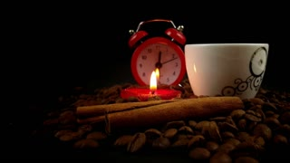 Cup of Coffee & Heart Candle & Cinnamon Sticks & Clock on Coffee Beans