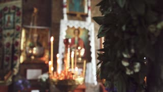 Altar with icons and candles in the ancient church