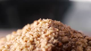 Making the dish in macro, cook adds sauce to the meal, food in slow motion