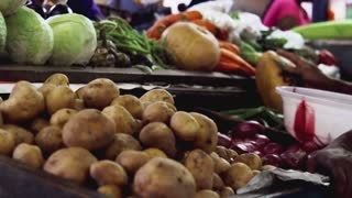 Man buys vegetables on indian local market