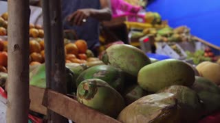 People buy exotic fruits on the local indian market
