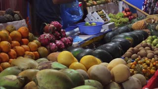 People buy fruits on the local indian market