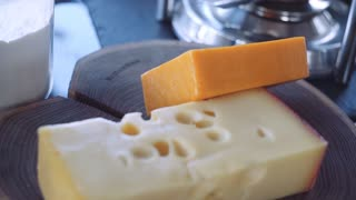 Pieces of cheese on a wooden board