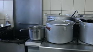 The Food is boiled in pots, pans and saucepans on the stove in the kitchen