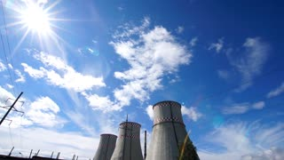 Time lapse: city power station under cloudy sky in sunny day