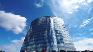 Time lapse: office building in down town in sunny day