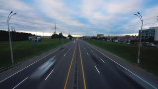 Time lapse: traffic on highway in the evening hours