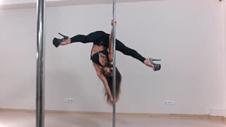 Beautiful sexy white pole dancer, woman is dancing near the pole, erotic dancing, choreography and sport, pole dance